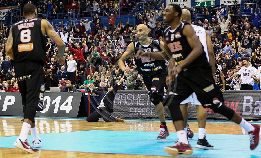 Leicester Riders Head Coach Rob Paternoster falls to his knees and raises his hands in celebration as his team clinch the thrilling Cup Final win at the NIA in Birmingham.